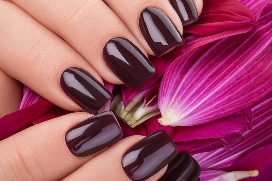 Dark red nail polish.